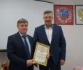вручение Приветственного адреса с Днем рождения заведующему отделом образования Тальменского района Е.В. Рожкову