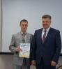 Вручение Почетной грамоты Е.В. Иванову за повышение социальной значимости отцовства в современном российском обществе