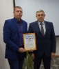 Вручение Приветственного адреса в связи с Днем энергетика М.В.  Сенич, начальнику Тальменского РЭС АО СК «Алтайкрайэнерго».